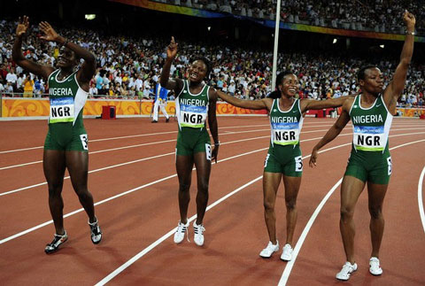 """WELL DONE GIRLS ••• Nigerian team of Oludamola Osayomi, Franca Idoko, Halimat Ismaila and Gloria Kemasuode celebrate taking bronze in the women's 4x100m relay final at the """"Bird's Nest"""" National Stadium during the 2008 Beijing Olympic Games on August 22, 2008.    Photo: AFP"""