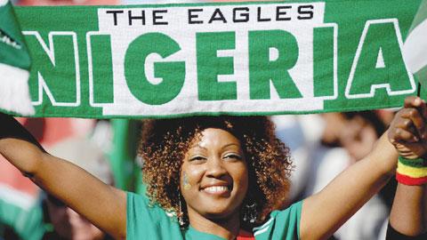 A Nigerian fan cheers prior to Argentina vs Nigeria
