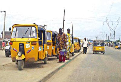Keke Marwa operators waiting for passengers