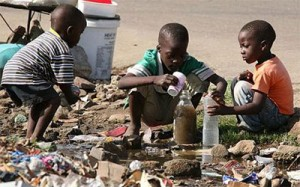Children collect stagnant water for use at home in Harare  Photo: AP