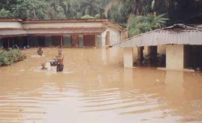 Residential buildings sacked by flood in Umuna.