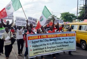 Cross section of workers during a protest rally by the Nigeria Labour Congress (NLC) and Labour & Civil Society Coalition (LASCO) during a joint 3 days warning strike to demand from government the #18,000 new minimum wage in Lagos yesterday   at the Murtala Mohammed way in Yaba Lagos Photo: Biodun Ogunleye
