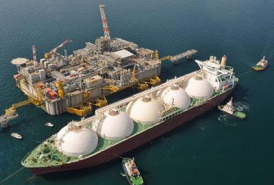 A liquefied natural gas carrier arrives at an Exxon Mobil terminal off Porto Levante.