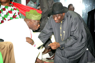 File photo:  Obasanjo and President Jonathan, putting heads together at the PDP convention.