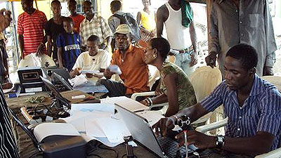 INEC officials at work:... premium on insurance covers for senior and ad hoc staff have not been paid to the firms.
