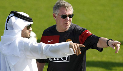 Sheik-up: Sir Alex Ferguson and a member of the Al Thani family during Man U's  visit to Qatar in January last year.