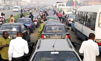Motorists in  a traffic gridlock  on Abuja–Keffi Road,  as a result of soldiers' check for bombs.
