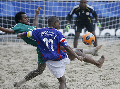 France's Jeremy Basquaise, right, battles for the ball with Nigeria's Ogbonnaya Okemmiri, during a past FIFA Beach Soccer World Cup match in Rio de Janeiro.