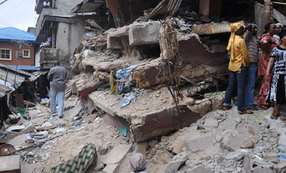Sympathisers and rescue workers at 4, Mogaji Lane off Johnson Street, behind SCOA Building, Idumota, Lagos where a four-storey building collapsed, Tuesday night.  10 persons were killed in the collapsed structure while several others remained trapped in it yesterday. Photo: Bunmi Azeez