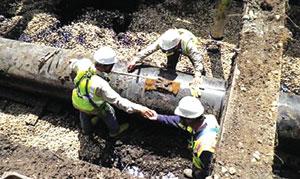 *Workers fixing a broken oil pipeline.
