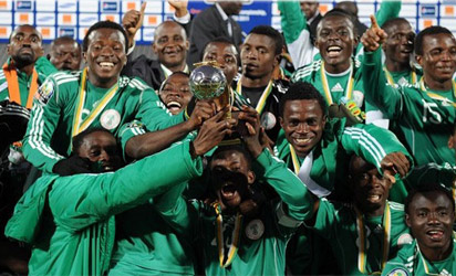 •Flying Eagles celebrating with their African trophy in South Africa.