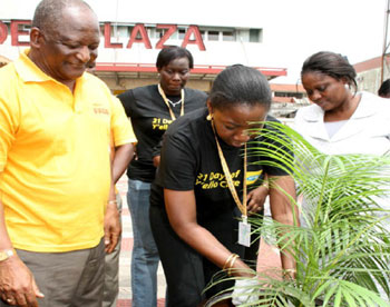• Mrs. Funmi Omogbenigun, GM, Corporate Communications, MTN, planting a tree to flag-off the annual MTN 21 Days of Y'ello Care, with support from Dr. Newton Jibunoh (left), Founder, Fade Africa and Mrs. Toyin Utomakili, Head, Tree Planting Programme, Lagos State Ministry of Environment, in Lagos.