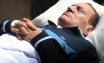 Egyptian ousted president Hosni Mubarak lies on a stretcher as he is wheeled into a courtroom in Cairo. Mubarak's trial resumed off camera with witnesses giving testimony to try to determine who gave the orders for killing of hundreds of protesters in the revolt that ousted Egypt's veteran president. AFP PHOTO