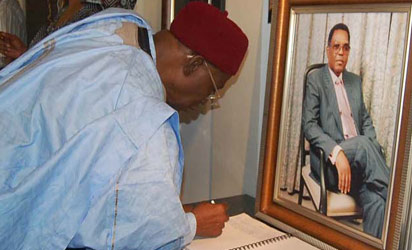 Late Dr. Umaru Dikko signing the condolence register during his condolence visit to the family of the late Alex Ibru, at their Ikoyi residence, on Tuesday.