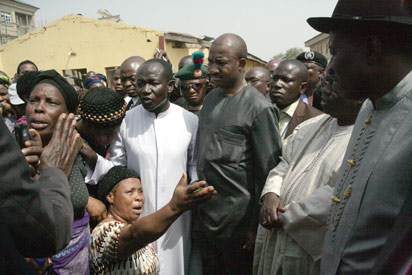 File photo: Nigerian President, Goodluck Jonathan listens to relatives of Christmas bomb blast's victims as he visits the damaged St. Theresa Catholic Church in Madalla on December 31. Photo: AFP