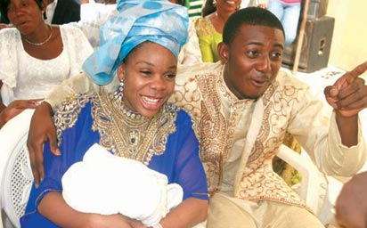 Kaffy, hubby during the naming ceremony of their first baby