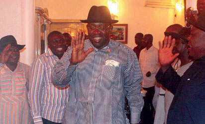 Governor-elect of Bayelsa State, Henry Dickson (middle) acknowledging cheers from supporters at his home after his victory at the 2012 Bayelsa State Governorship election in Yenagoa, Bayelsa, yesterday. Photo: Nwankpa Chijioke