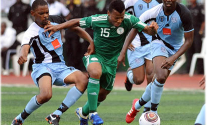BREAKING THROUGH . . .  Super Eagles attacker, Ike Uche tries to go past Botswana defence during a friendly match at Ogbe stadium in Benin City, Edo State. Eagles won 2-0.