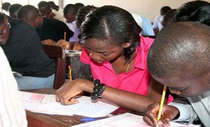 File Photo: Cross section of students writing exam