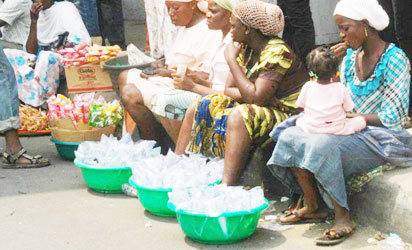 Pure (sachet) water peddlers in the Sun in Lagos