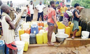 Lagos residents at a public water supply point