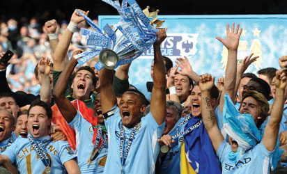 File photo: Manchester City's Belgian captain, Vincent Kompany lifts the Premier league trophy after their 3-2 victory over Queens Park Rangers in the English Premier League football match  AFP PHOTO