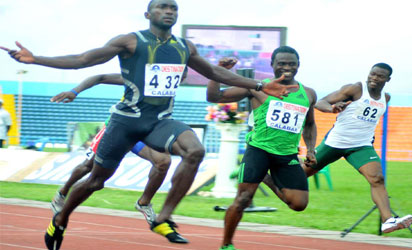 BULLET METU•••Obinna Metu (left) outpaces Egwero Ogho-Oghene to win the 100m men's final in a time of 10.11sec at the 66th CRS Ail Nigeria Athletics Championship in Calabar yesterday. Photo by Sylva Eleanya.
