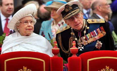 Britain's Queen Elizabeth (L) and Prince Philip, Duke of Edinburgh, standing onboard the Spirit of Chartwell during the Thames Diamond Jubilee Pageant on the River Thames in London. Prince Philip, Queen Elizabeth II's 90-year-old husband, was hospitalised June 4, 2012 with a bladder infection and will miss the rest of her diamond jubilee celebrations, Buckingham Palace said.   AFP PHOTO