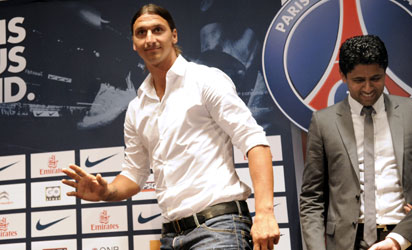 Paris Saint-Germain (PSG) football club's newly recruited Sweden striker Zlatan Ibrahimovic (L) and Paris Saint-Germain (PSG) football club's chairman Nasser Al-Khelaifi arrive to give a press conference as part of Ibrahimovic's official presentation at the Parc des Princes on July 18, 2012 in Paris.  AFP PHOTO