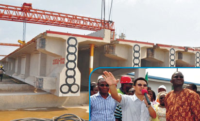 File Photo: On-going structure at the new rail line. INSET: Gov. Fashola being briefed by contractors at construction site