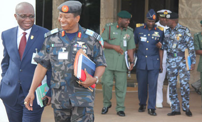 Chief of Defence Staff, Air Chief Marshal Oluseyi Petinrin (2nd left) and other security chiefs after a security council meeting chaired by President Goodluck Jonathan at the State House, Abuja, yesterday. Photo: Abayomi Adeshida.