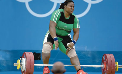 DOWN & OUT . . . Team Nigeria's female weightlifter hopeful, Maryam Usman disappointed as she flops during the women's +75-kg weightlifting event of the London 2012 Olympics.