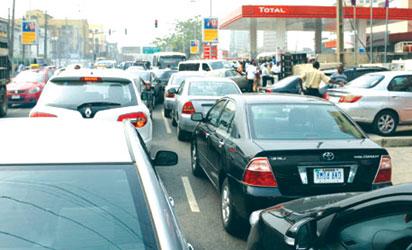 File photo: Long queue at a  petrol filling station