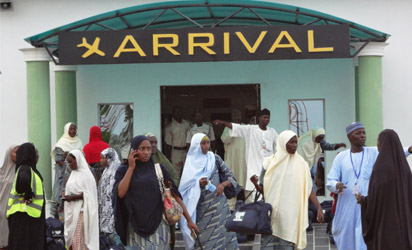 Nigerian pilgrims leave the arrival hall of Mallam Aminu Kano International Airport shortly after their arrival from the muslim holy city of Madina recently. AFP PHOTO