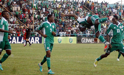 File photo: Super Eagles celebrating one of Victor Moses goals...qualify for Afcon