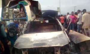An ATM at GTBank and a police patrol van destroyed by the robbers