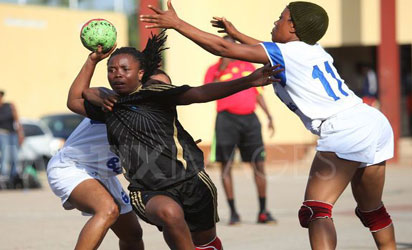 A female handball player sandwiched during a handball match in Abuja.