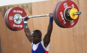 GOOD FOR SILVER......Jubrin Abubakar of Delta State hauls 143kg in the Clean and Jerk to win the silver medal. Photo: AFP