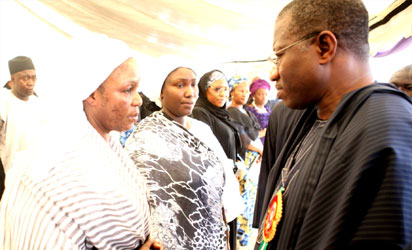 President Goodluck Jonathan consoling wife of late Sir  Patrick Yakowa during the burial ceremony.