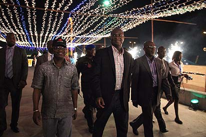 File photo: Governor Babatunde Fashola of Lagos State (2nd left) with other state officials during the switching on of the Festival of Lights, last Thursday night, in Lagos.