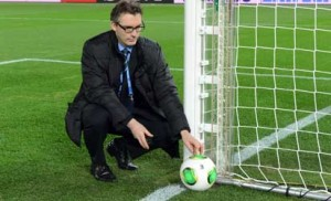 "TO GO WITH Fbl-Asia-WClub-2012-technology by Peter Hutchison This photo taken on December 5, 2012 shows a FIFA official displaying new goal-line technology developed by GoalRef for the media in Yokohama ahead the start of the Club World Cup football tournament taking place in Japan from December 6 to 16.  FIFA called it a ""revolution"""