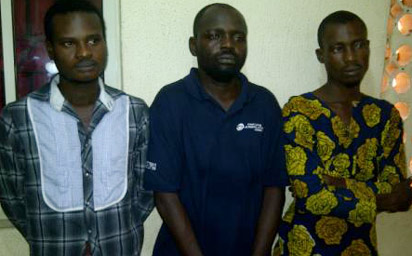 Kolawole (center)and the suspected members of his gand