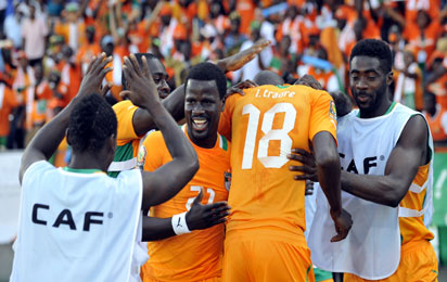 Ivory Coast players celebrate after forward Gervinho scored a goal against Tunisia during the 2013 African Cup of Nations match at Royal Bafokeng Stadium in Rustenburg. AFP PHOTO
