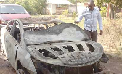 Ikyange with the burnt car
