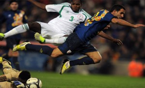 Catalonia's Martin Montoya (R) vies with Nigeria's Benjamin Francis during the friendly football match between the selection of Catalonia and Nigeria at the Cornella-El Prat stadium in Cornella de Llobregat on January 2, 2013. AFP PHOTO