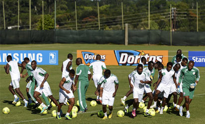 Nigeria's players warm up during a training session in Nelspruit on January 24, 2013, on the eve of a 2013 Africa Cup of Nations goup C football match against reigning champions Zambia.   AFP PHOTO