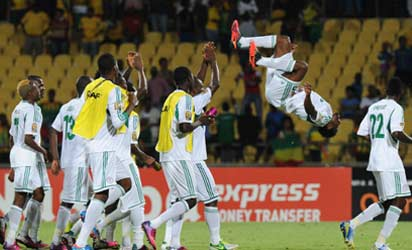 CELEBRATION . . . Super Eagles defender Efe Ambrose (2nd R) celebrates with an acrobatic display after Nigeria defeated Ethiopia 2-0  in their last Group C match  of AFCON 2013 at the Royal Bafokeng stadium in Rustenburg.  Photo: AFP