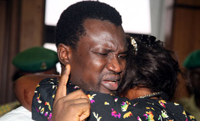 The wife of the convict, Tessy Ebiware with her husband Edmund Ebiware after he was sentenced to life imprisonment at Federal High Court Abuja on Friday. Photo by Gbemiga Olamikan