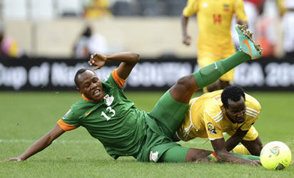 Zambia's Stoppila Sunzu (L) battles for the ball with Ethiopia's Said Ahmed during yesterday's match at Mbombela Stadium in Nelspruit. It ended 1-1.PHOTO: AFP