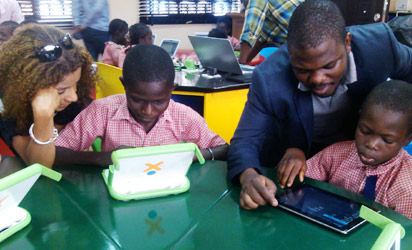 Some of the students being shown how to use laptop computers during the demonstration exercise